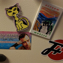 f plus logo on the fridge with several other magnets