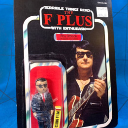 a toy of Roy Orbison wrapped in Clingfilm by Jimmyfranks