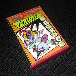 front of Audio Garbage cassette case, on black