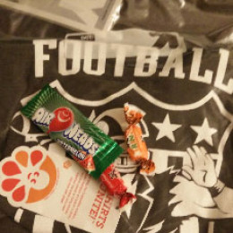 a bag with a jersey and some candy