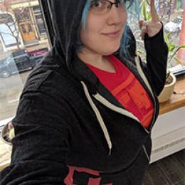 hoodie in an office building, overlooking street