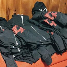 a pile of F+ hoodies