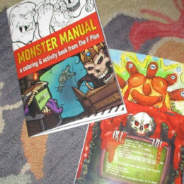 photo of front and back covers of the F Plus Monster Manual