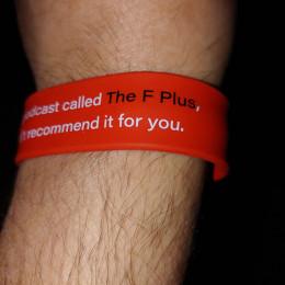 a slap bracelet around another wrist