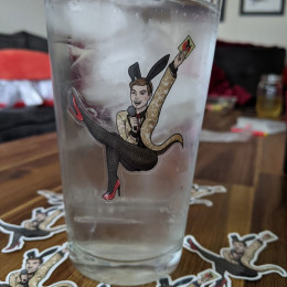 a clear sexy bunnybread sticker on a pint glass