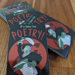 a pile of It's Time For Poetry stickers